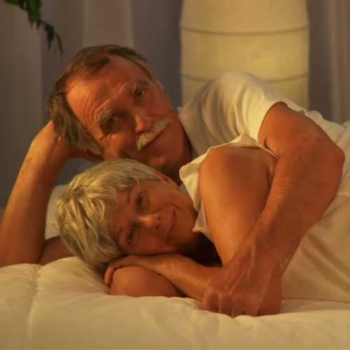 Why Live-in Care - image couple-bed on https://grandmajoan.com